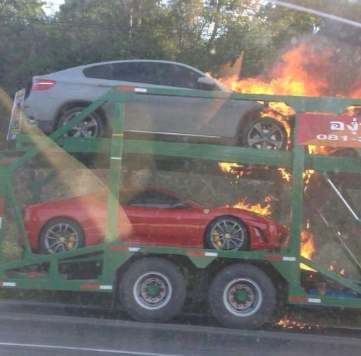 Supercars on truck in flames in Thailand-6