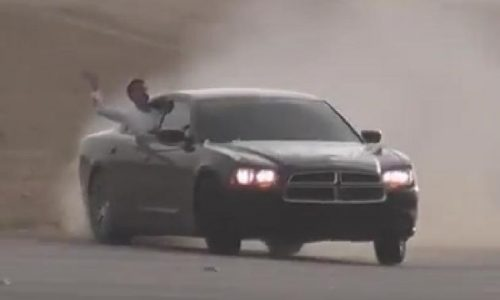 Dodge Charger sedan drifting at 220km/h in the Middle East