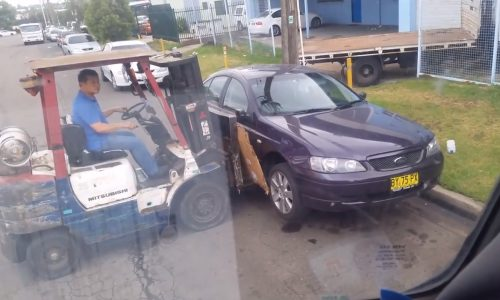 Sydney worker uses forklift to move legally parked car (video)