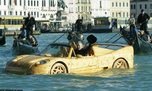 Italian sculptor cruises Venice in wooden Ferrari F50 (video)