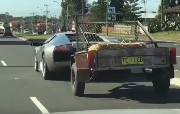 Lamborghini Murcielago towing trailer