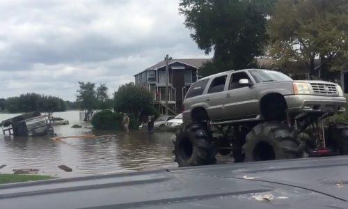 Monster trucks rescue stranded army truck in Houston floods (video)