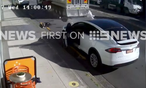 Video: Tesla Model X automatic door gets ripped off by truck