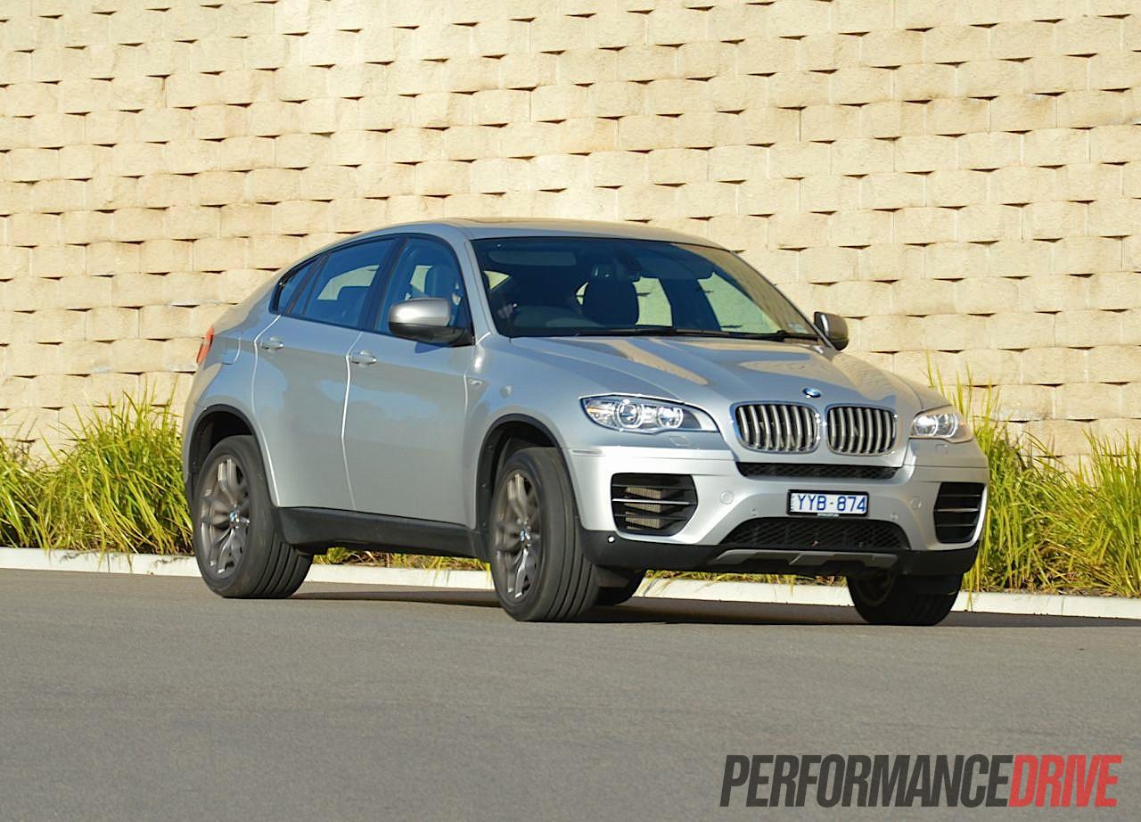 2012 BMW X6 M50d Titanium Silver Driving