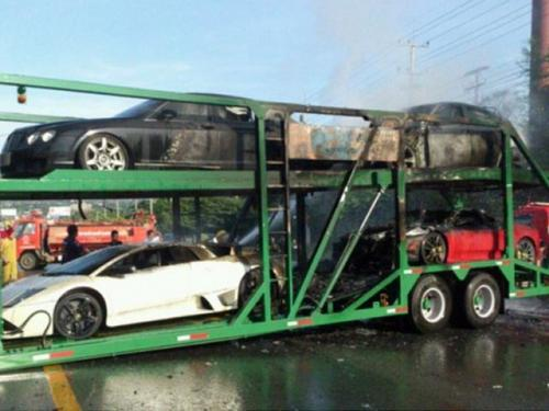 Supercars on truck in flames in Thailand-1