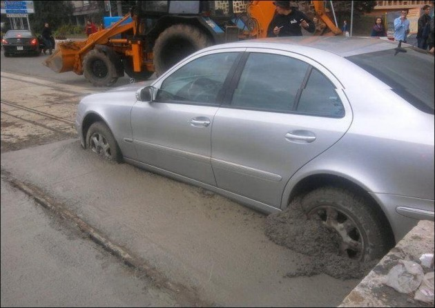 Mercedes-Benz E-Class bogged in cement