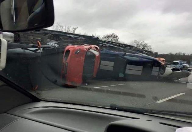 Truck carrying supercars crash France-1
