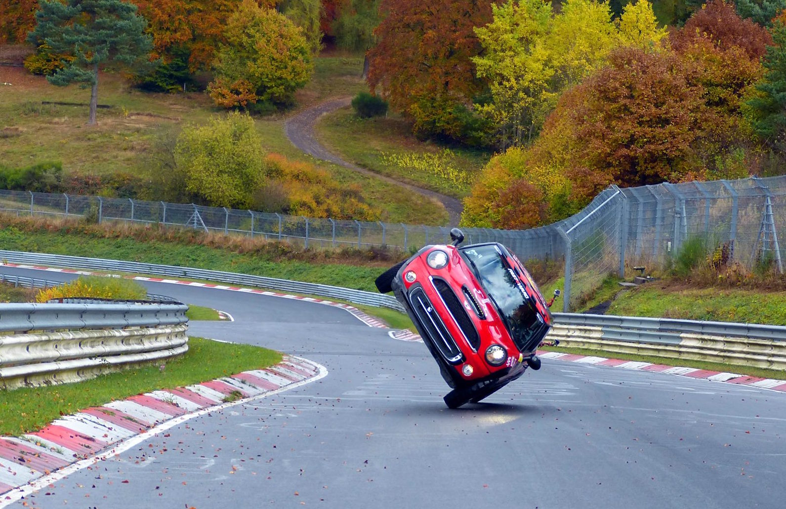 mini cooper laps nurburgring on two wheels for record video performancedrive. Black Bedroom Furniture Sets. Home Design Ideas