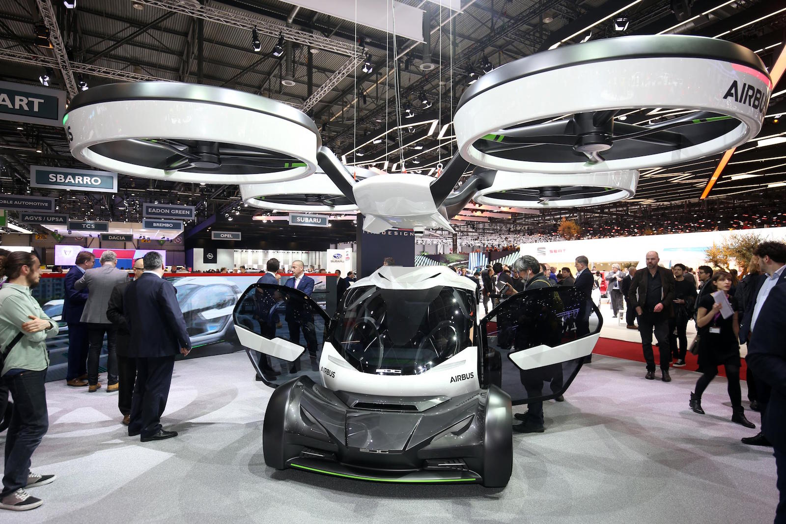 When The Vehicle Encounters Congestion A Drone With Eight Rotor Blades Can Be Summoned To Unburden Rolling Chassis Of Passenger Pod And Carry It