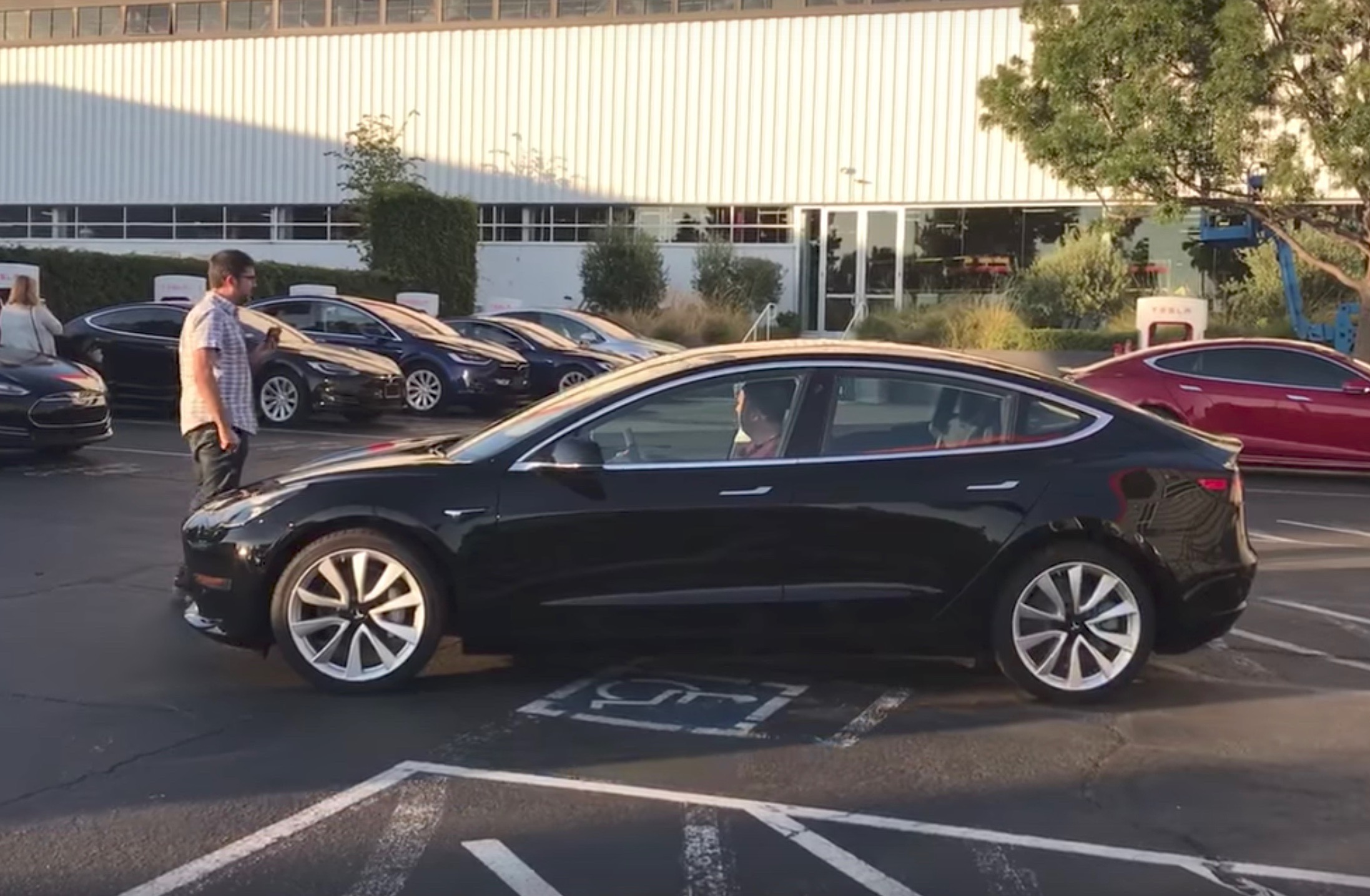 First Tesla Model 3 Rolls Off The Production Line Video