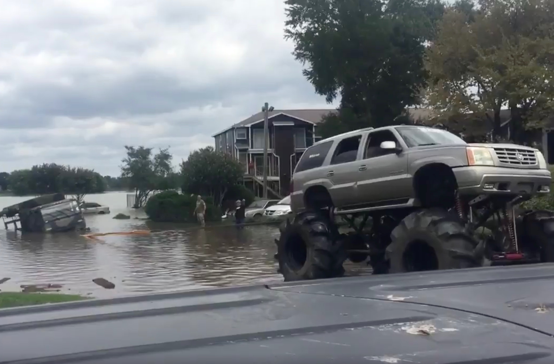 Monster trucks rescue stranded army truck in Houston floods